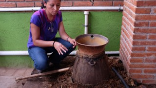 Graciella explaining the fine points of clay pot distillation